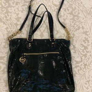 Black and gold MK bag